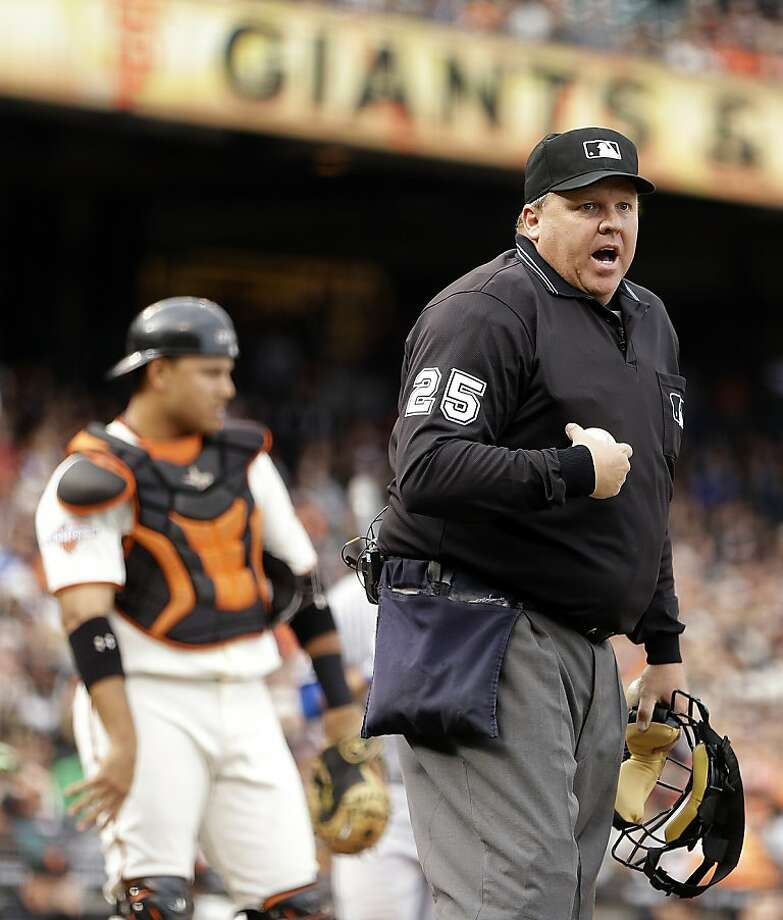 Home plate umpire Fieldin Culbreth, right, yells at the Los Angeles Dodgers dugout in the second inning of a baseball game against the San Francisco Giants Sunday, May 5, 2013, in San Francisco. (AP Photo/Ben Margot) Photo: Ben Margot, Associated Press