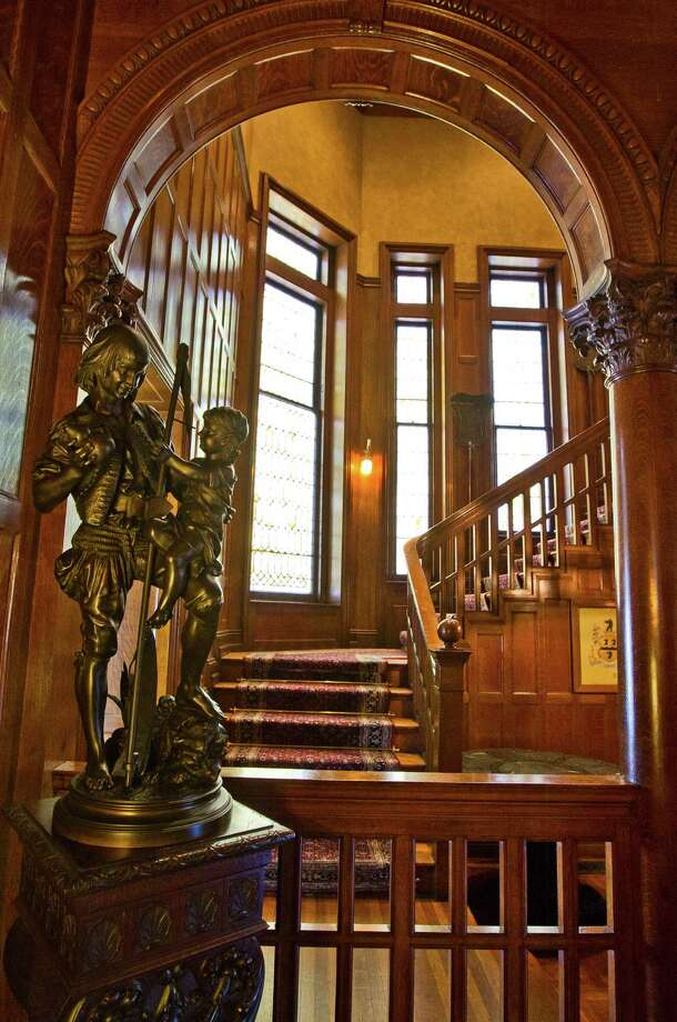 Stained glass windows enhance the mansion's ornate stairway. Photo: Nick De La Torre, Staff / © 2013 Houston Chronicle