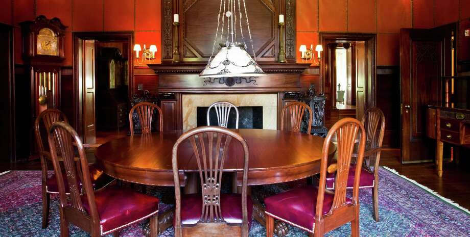 The dining room of the Open Gates historic mansion has its grandfather clock in the corner. Photo: Nick De La Torre, Chronicle / © 2013 Houston Chronicle