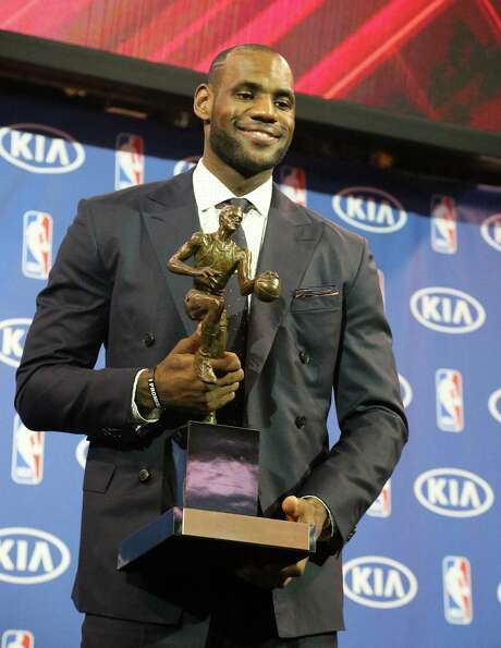 Miami's LeBron James won his fourth MVP with 120 of 121 possible first-place votes. Photo: Hector Gabino / MCT