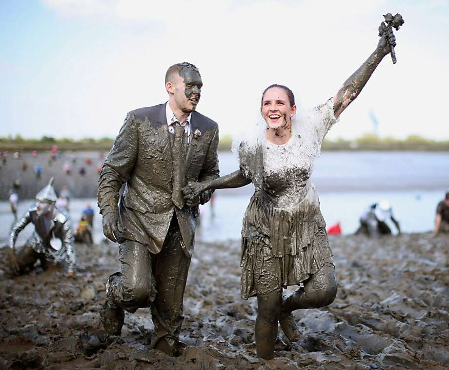MALDON, ENGLAND - MAY 05:  A couple dressed as a bride and groom take part in the Maldon Mud Race on May 05, 2013 in Maldon, Essex. The race originated in 1973 and involves competitors racing around a course on the mudbanks of the river Blackwater at low tide.  (Photo by Dan Kitwood/Getty Images) *** BESTPIX *** Photo: Dan Kitwood, Getty Images
