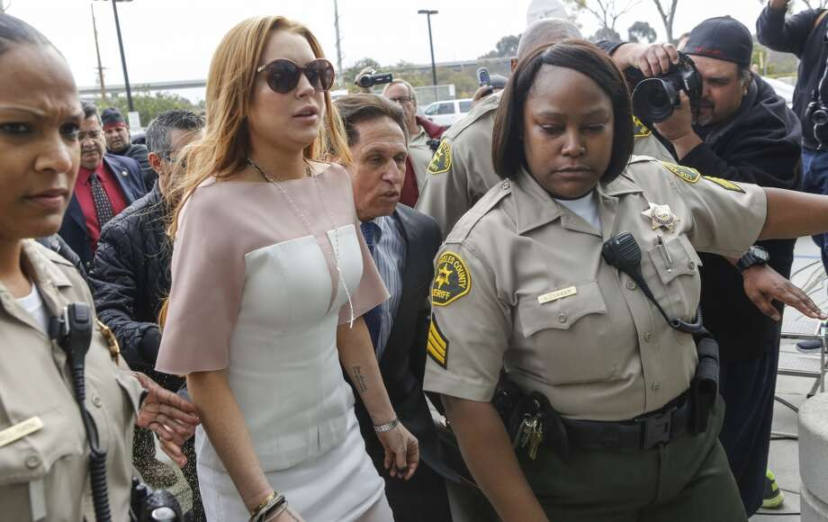 Actress Lindsay Lohan arrives at the Los Angeles Superior court Monday, March 18, 2013. Lohan is charged with three misdemeanor counts stemming from a crash on Pacific Coast Highway. She is charged with willfully resisting, obstructing or delaying an officer, providing false information to an officer and reckless driving. She is also accused of violating her probation in a misdemeanor jewelry theft case.