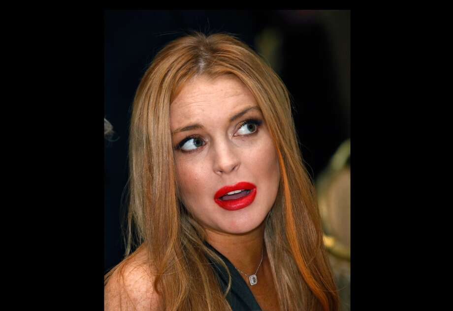 In this April 28, 2012,  photo, Lindsay Lohan attends the White House Correspondents' Association Dinner in Washington. A law enforcement official says a 25-year-old man got into an argument with Lohan, Sunday, Sept. 30, 2012, in her New York City hotel room over photos on a cellphone and she was physically grabbed or thrown. Authorities confirm that Christian LaBella of Valley Village, Calif., was taken into custody around 6 a.m. He faces a misdemeanor assault charge.