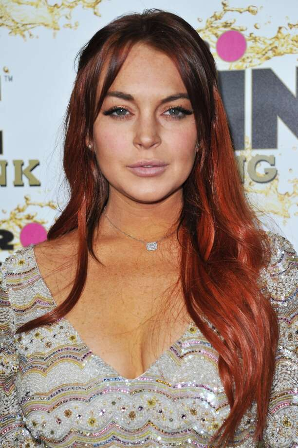 Oct. 11, 2012: Lindsay Lohan attends the Mr. Pink Ginseng launch party at the Beverly Wilshire hotel in Beverly Hills, Calif. Lohan is due to be arraigned on Wednesday, Dec. 12, 2012 on three misdemeanor charges filed after authorities say they determined the actress lied about being a passenger when her Porsche slammed into the back of a dump truck in June.