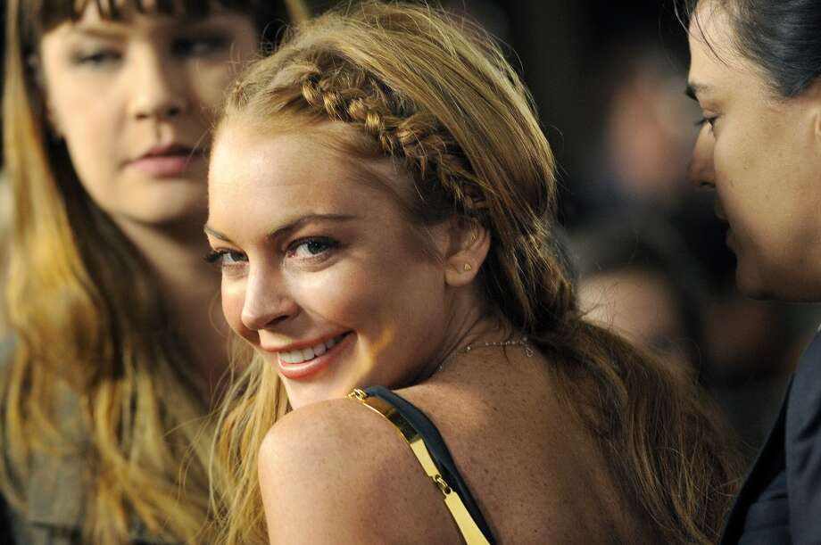 "This April 11, 2013 file photo shows actress Lindsay Lohan, a cast member in ""Scary Movie V,"" at the premiere of the film in Los Angeles. Lohan's lawyer Mark Jay Heller told a judge at a May 2, 2013 hearing that Lohan had checked into a rehab facility per a judge's orders."