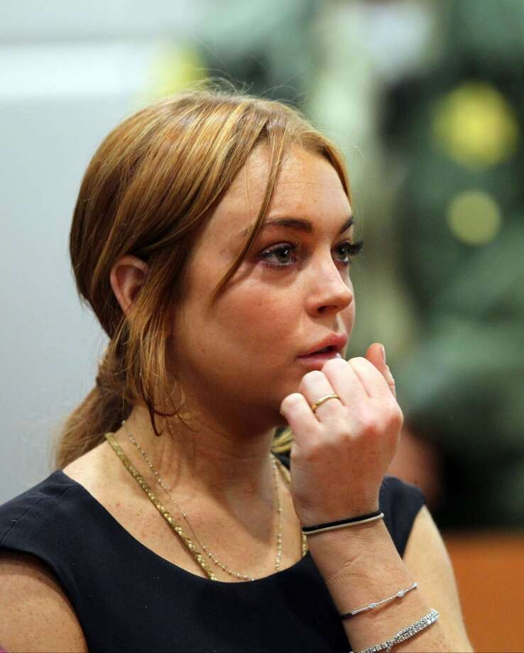 Actress Lindsay Lohan appears in Los Angeles court for a pretrial hearing, Wednesday, Jan. 30, 2013, in a case filed over the actress' June car crash. Lohan faces three misdemeanor charges and a return to jail if convicted in the case or if a judge finds she violated her probation.