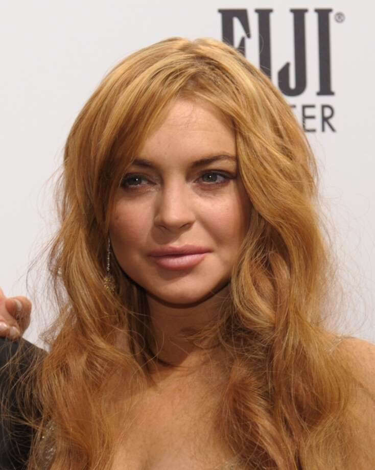 Lindsay Lohan arrives at the amfAR (The Foundation for AIDS Research) gala that kicks off the Mercedes-Benz Fashion Week in this February 6, 2013 photo in New York.