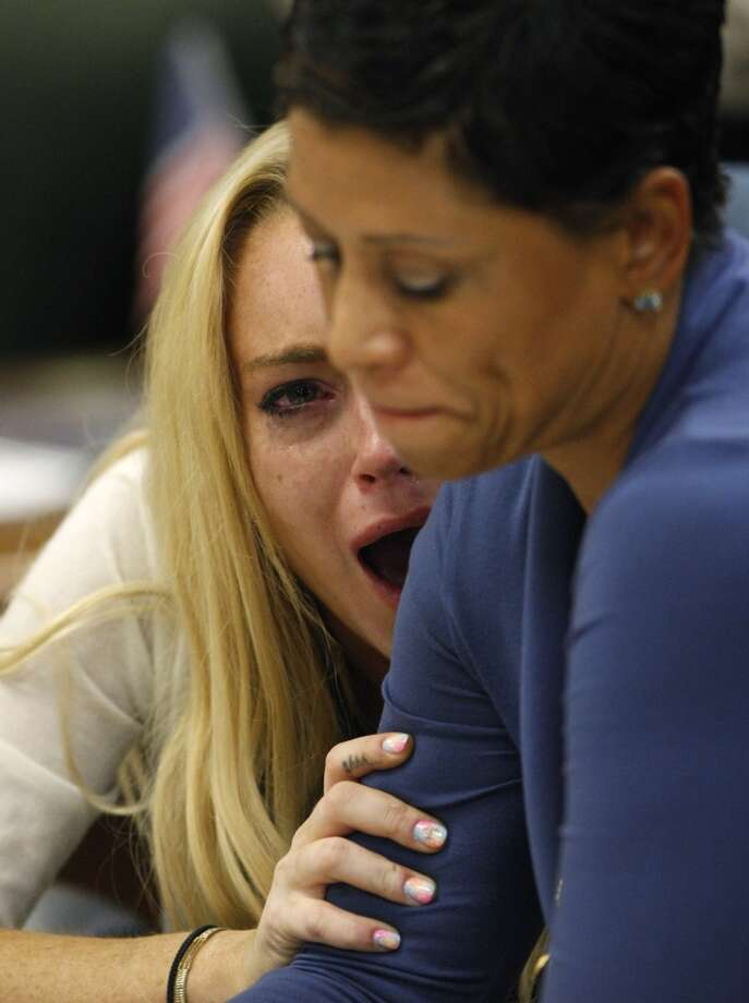 Actress Lindsay Lohan, left, reacts with her attorney Shawn Chapman Holley after the sentencing by Superior Court Judge Marsha Reve during a hearing in Beverly Hills, Calif., Tuesday, July 6, 2010. The judge sentenced Lindsay Lohan to 90 days in jail Tuesday after ruling she violated probation in a 2007 drug case by failing to attend court-ordered alcohol education classes.