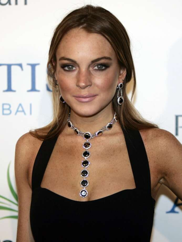 In this Nov. 20, 2008 file photo U.S. actress Lindsay Lohan arrives on the red carpet at the Atlantis hotel grand opening on Jumeirah Palm Island in Dubai, United Arab Emirates.