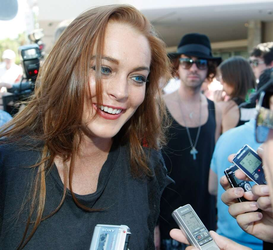 Lindsay Lohan is interviewed as she arrives at the Wet Republic pool at the MGM Grand Hotel/Casino to celebrate her birthday and her Sevin Nyne brand tanning mist June 27, 2009 in Las Vegas, Nevada. Lohan turned 23 that July 2.