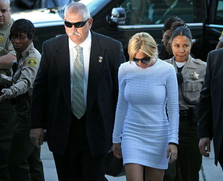 Actress Lindsay Lohan arrives to court for an arraignment hearing in connection with the alleged theft of a $2,500 necklace on February 9, 2011 in Los Angeles, California. Lohan has been charged with a felony count of grand theft for allegedly walking out of a Venice, California store with the necklace in January.