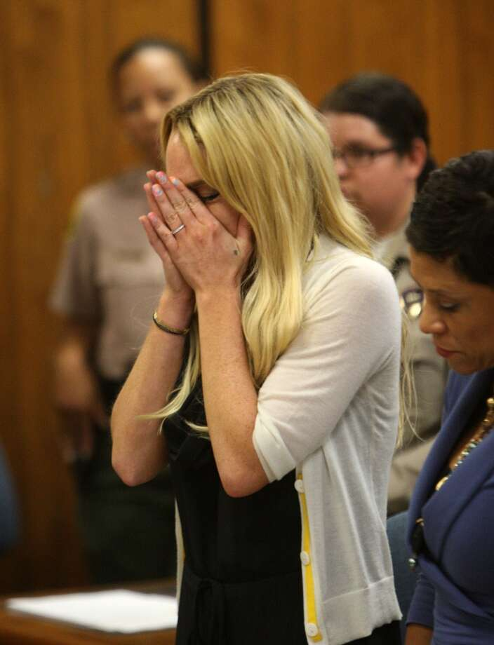 Actress Lindsay Lohan breaks down as she talks to Judge Marsha Reve during a hearing in Beverly Hills, Calif., Tuesday, July 6, 2010.
