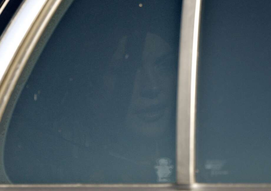 Actress Lindsay Lohan is seen through a tinted car window inside an unmarked police car as she arrives at Century Regional Detention Facility (CRDF) Friday, Sept. 24, 2010, in Lynwood, Calif. Lohan returned to jail in handcuffs Friday after a judge refused to set bail and ordered her to remain in custody for failing a drug test until another hearing on Oct. 22.