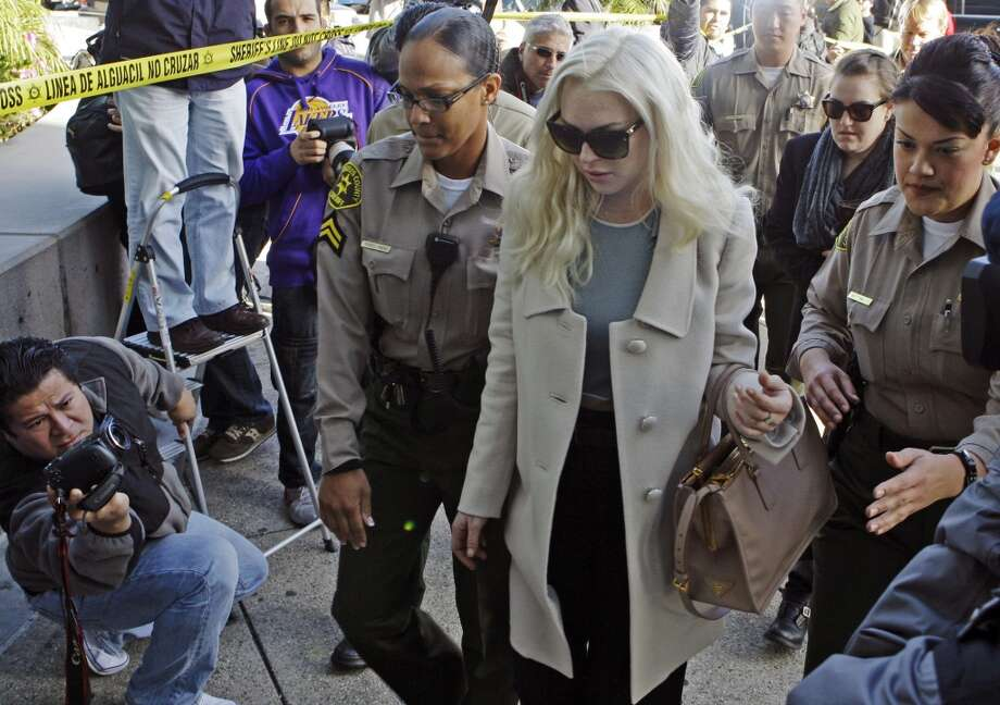 Lindsay Lohan arrives at Los Angeles Superior Court for a probation progress hearing Tuesday, Jan. 17, 2012. Lohan remains on probation for convictions in a 2007 drunken driving case and a grand theft case in 2011.