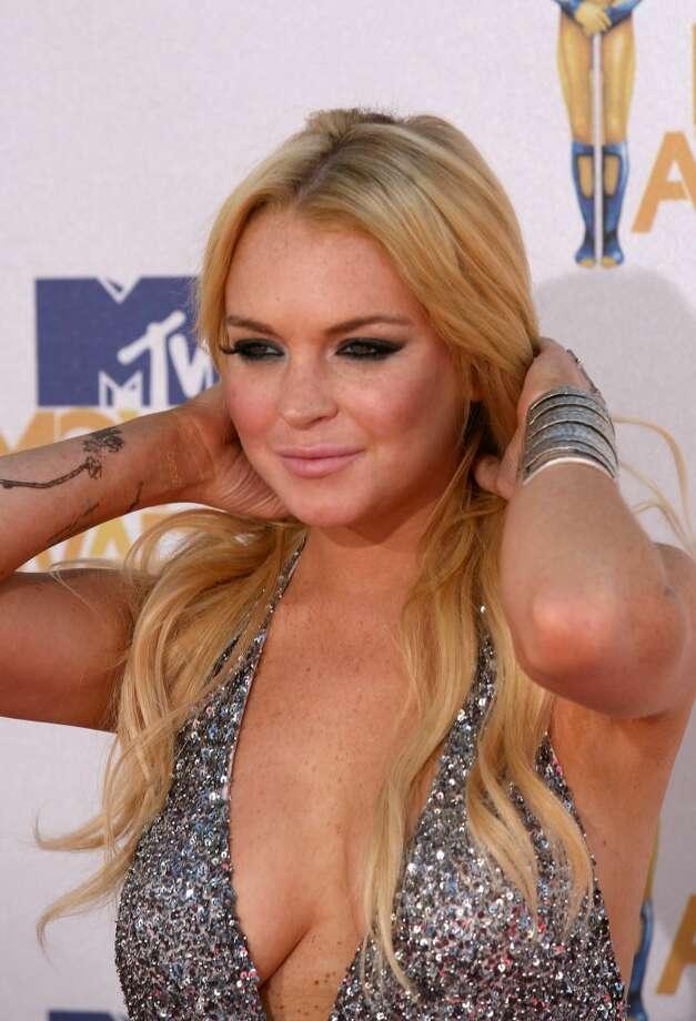 Lindsay Lohan arrives at the MTV MovieAwards at Universal Studios in Universal City, California, on June 6, 2010.