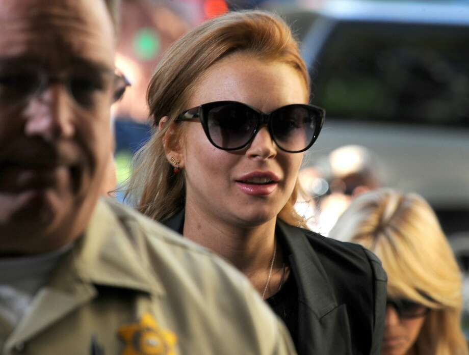 Actress Lindsay Lohan arrives at the Beverly Hills Municipal Courthouse September 24, 2010 in Beverly Hills, California. Lohan was ordered back to jail today for failing a court-ordered drug test. Superior Court Judge Elden S. Fox, who earlier this week revoked the 24-year-old actress' probation, set no bail, pending an October 22 probation hearing, meaning Lohan could spend the next 30 days behind bars.
