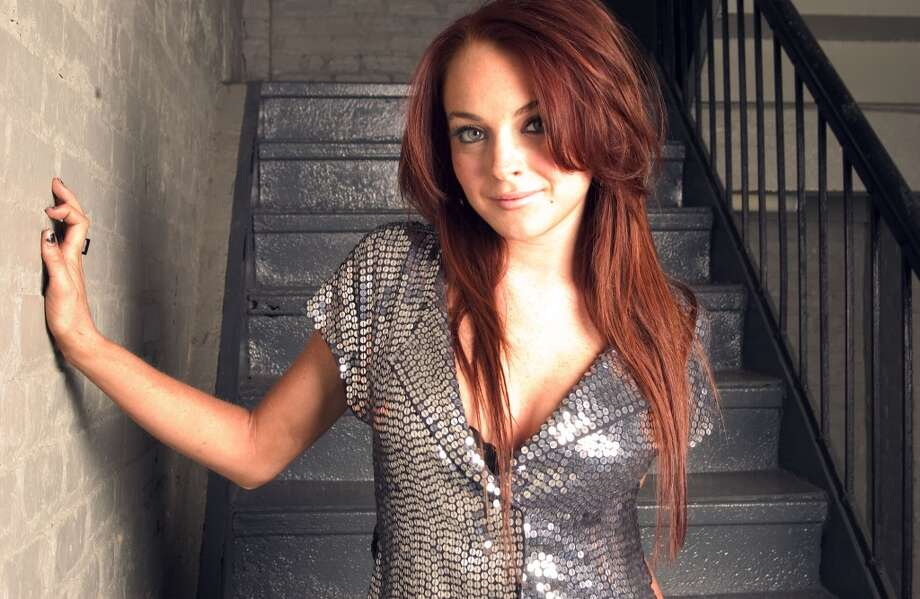 Actress and singer Lindsay Lohan poses for a photo at the Hit Factory music studios in New York, Dec.  2, 2004.