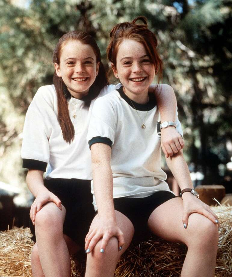 Lindsay Lohan stars in the dual roles of Annie James, (left), and Hallie Parker, (right), identical twins who don't know the other existed until a chance meeting at summer camp, in Walt Disney Pictures' ''The Parent Trap,'' released in 1998.