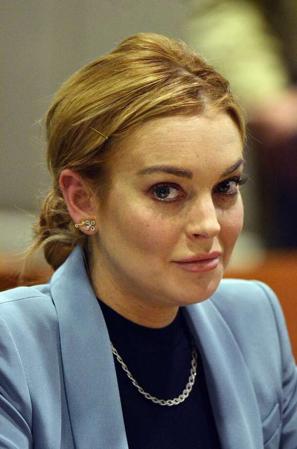 Lindsay Lohan has been arrested for an alleged hit and run in New York. Actress Lindsay Lohan attends a probation progress report hearing at Superior Court in Los Angeles, California, March 29, 2012. Los Angeles Superior Court Judge Stephanie Sautner decided to take Lohan off probation from a 2007 drunken driving case. Sautner also decided that Lohan will no longer have to meet with a probation officer or appear in court on her 2011 shoplifting case, as long as she obeys all laws through May 2014.