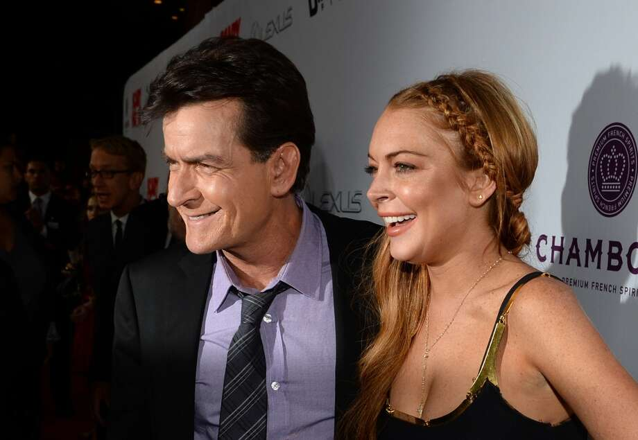 "Actors Charlie Sheen and Lindsay Lohan arrive for the premiere of Dimension Films' ""Scary Movie 5"" at ArcLight Cinemas Cinerama Dome on April 11, 2013 in Hollywood,."