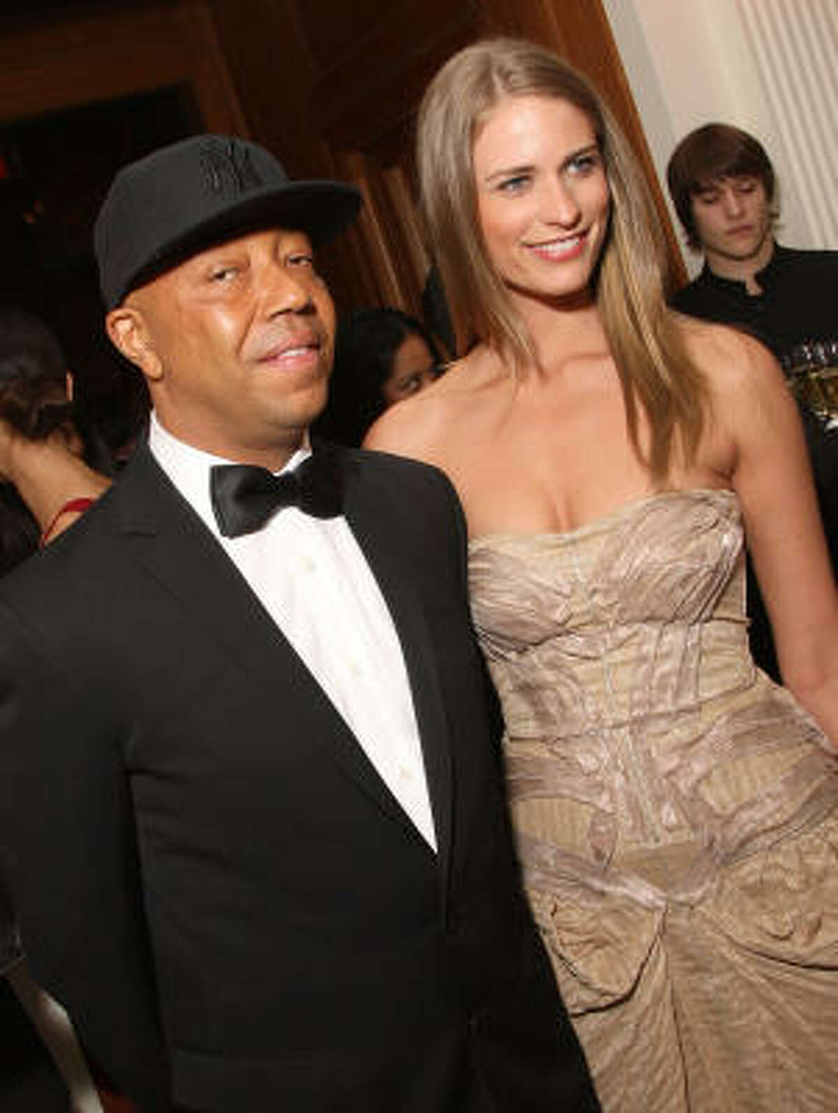 Model Julie Henderson and Russell Simmons at the Cartier 100th Anniversary in America Celebration at Cartier Fifth Avenue Mansion in New York City.
