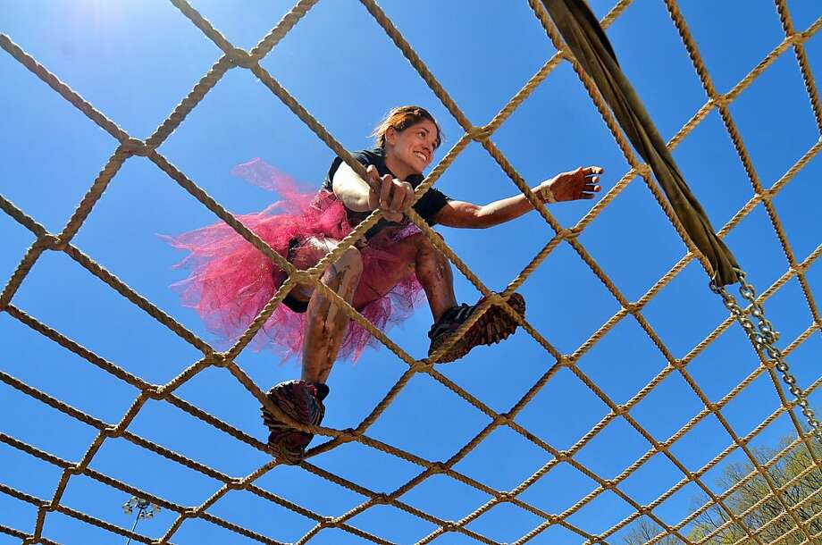 "Alaina Avery, of Palmyra Pa., climbs over the ""Funky Monkey"" obstacle, during the Dirty Girl Mud Run held at Toyota Pavilion at Montage Mountain, Moosic, Pa., on Sunday, May 5, 2013. (AP Photo/Scranton Times & Tribune, Jason Farmer) Photo: Jason Farmer, Associated Press"
