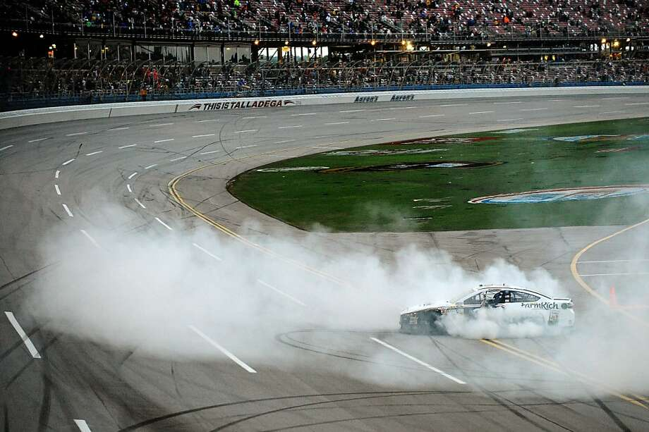 David Ragan celebrates after winning the NASCAR Sprint Cup Series Aaron's 499 auto race at Talladega Superspeedway, Sunday, May 5, 2013 in Talladega, Ala. (AP Photo/Jared C. Tilton, Pool) Photo: Jared C. Tilton, Associated Press