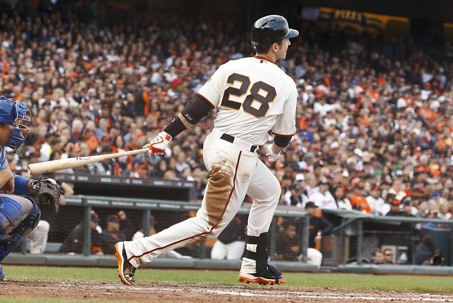 SAN FRANCISCO, CA - MAY 05: Buster Posey #28 of the San Francisco Giants hits a single against the Los Angeles Dodgers during the fifth inning at AT&T Park on May 5, 2013 in San Francisco, California. (Photo by Jason O. Watson/Getty Images) Photo: Jason O. Watson, Getty Images
