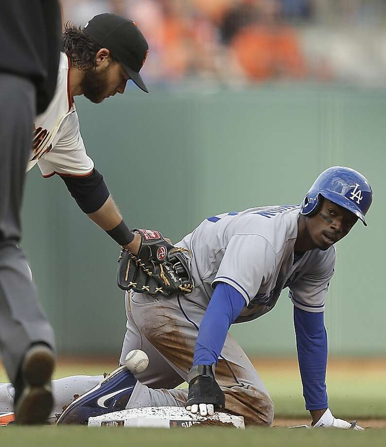 Los Angeles Dodgers' Dee Gordon, right, steals second base as San Francisco Giants shortstop Brandon Crawford drops the ball in the fifth inning of a baseball game, Sunday, May 5, 2013, in San Francisco. (AP Photo/Ben Margot) Photo: Ben Margot, Associated Press