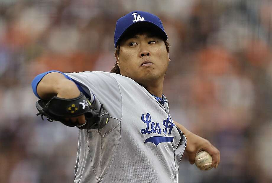 Los Angeles Dodgers' Hyun-Jin Ryu, of South Korea, works against the San Francisco Giants in the first inning of a baseball game, Sunday, May 5, 2013, in San Francisco. (AP Photo/Ben Margot) Photo: Ben Margot, Associated Press