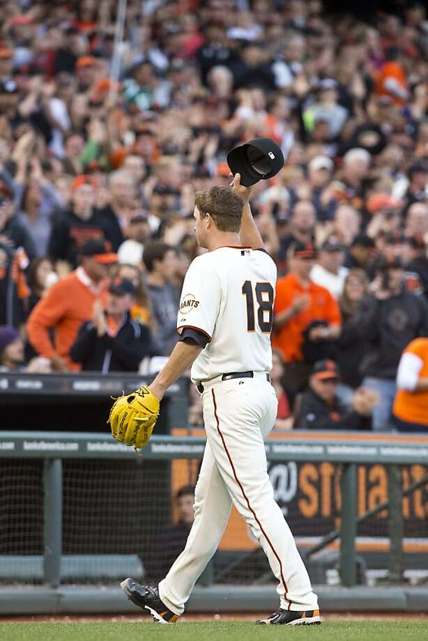 SAN FRANCISCO, CA - MAY 05: Matt Cain #18 of the San Francisco Giants tips his hat to the crowd after being relieved against the Los Angeles Dodgers during the eighth inning at AT&T Park on May 5, 2013 in San Francisco, California. (Photo by Jason O. Watson/Getty Images) Photo: Jason O. Watson, Getty Images