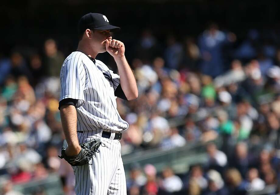 NEW YORK, NY - MAY 05: Boone Logan #48 of the New York Yankees reacts after giving up a solo home run in the eighth inning against the Oakland Athletics at Yankee Stadium on May 5, 2013 in the Bronx borough of New York City.  (Photo by Nick Laham/Getty Images) Photo: Nick Laham, Getty Images