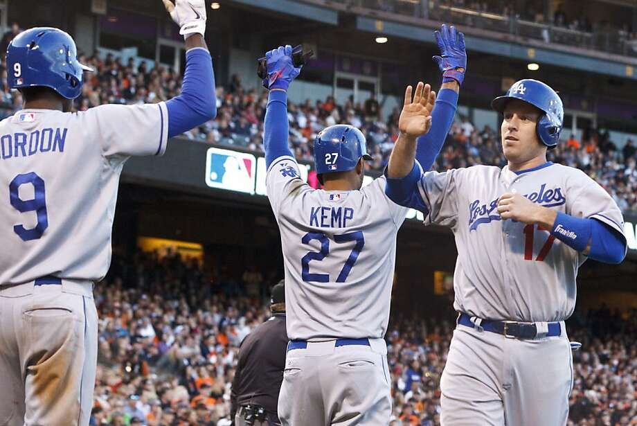 SAN FRANCISCO, CA - MAY 05:  A.J. Ellis #17 of the Los Angeles Dodgers is congratulated by Matt Kemp #27 and Dee Gordon #9 after Ellis and Kemp scored runs against the San Francisco Giants during the eighth inning at AT&T Park on May 5, 2013 in San Francisco, California. (Photo by Jason O. Watson/Getty Images) Photo: Jason O. Watson, Getty Images