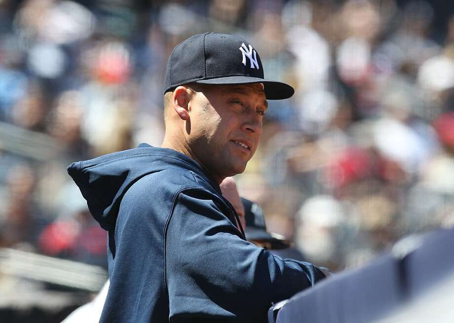 Injured New York Yankees shortstop Derek Jeter talks in the dugout during a baseball game against the Oakland Athletics in New York on Sunday, May 5, 2013. (AP Photo/Peter Morgan) Photo: Peter Morgan, Associated Press
