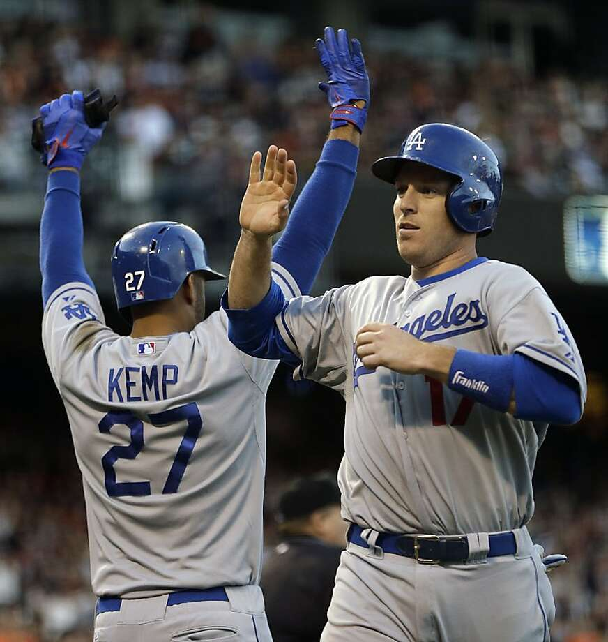 Los Angeles Dodgers' Matt Kemp (27) and teammate A.J. Ellis celebrate as they score against the San Francisco Giants in the eighth inning of a baseball game, Sunday, May 5, 2013, in San Francisco. Both scored on a single by Dodgers' Adrian Gonzalez. (AP Photo/Ben Margot) Photo: Ben Margot, Associated Press