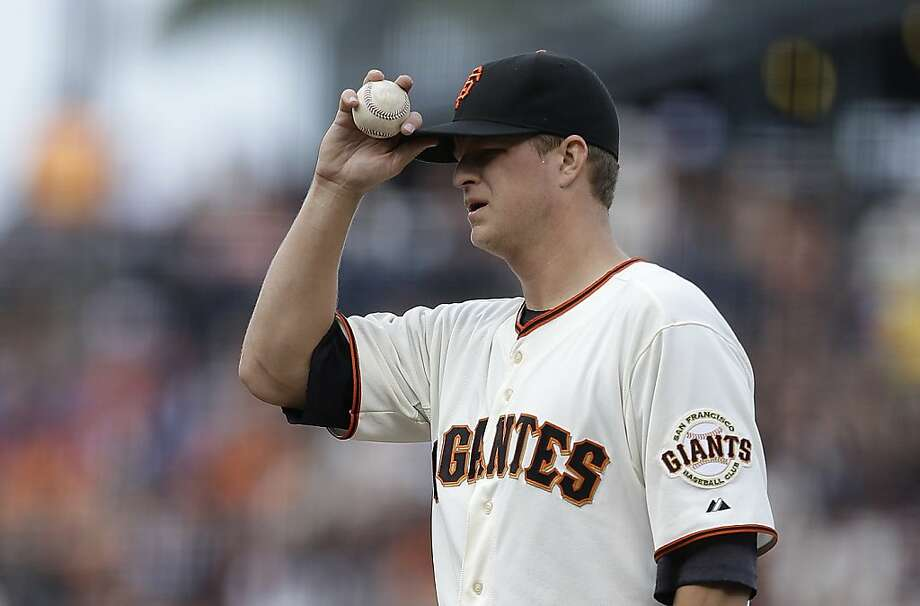 San Francisco Giants' Matt Cain adjusts his cap in the first inning of a baseball game against the Los Angeles Dodgers, Sunday, May 5, 2013, in San Francisco. (AP Photo/Ben Margot) Photo: Ben Margot, Associated Press