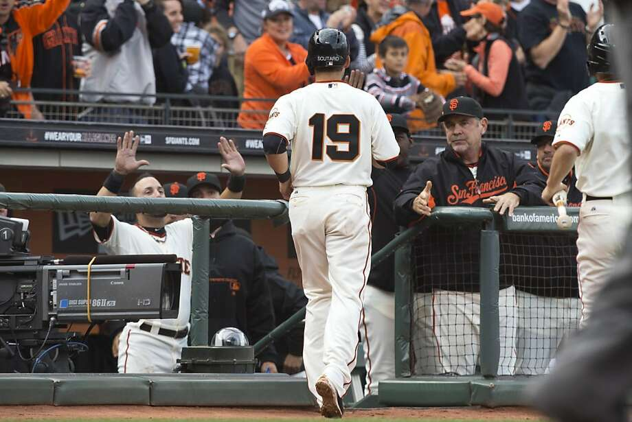 SAN FRANCISCO, CA - MAY 05:  Marco Scutaro #19 is congratulated by Bruce Bochy #15 of the San Francisco Giants (right) after scoring a run against the Los Angeles Dodgers during the third inning at AT&T Park on May 5, 2013 in San Francisco, California. (Photo by Jason O. Watson/Getty Images) Photo: Jason O. Watson, Getty Images