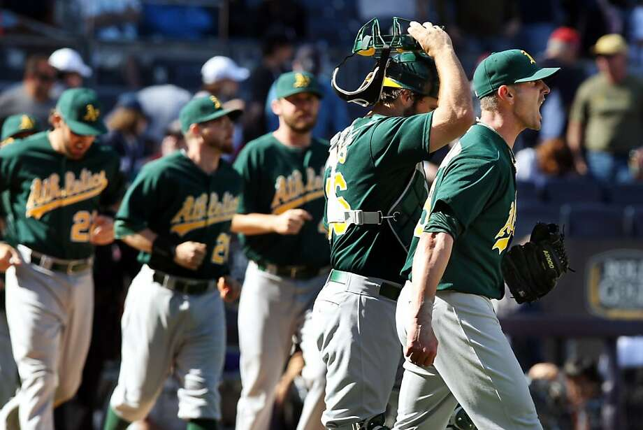 Oakland Athletics relief pitcher Grant Balfour, right, shouts to teammates after their 5-4 win over the New York Yankees in a baseball game in New York, Sunday, May 5, 2013. (AP Photo/Peter Morgan) Photo: Peter Morgan, Associated Press
