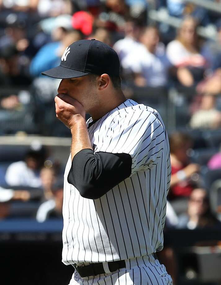 New York Yankees starting pitcher Andy Pettitte leaves the baseball game at the end of the fifth inning against the Oakland Athleticsin New York on Sunday, May 5, 2013. (AP Photo/Peter Morgan) Photo: Peter Morgan, Associated Press