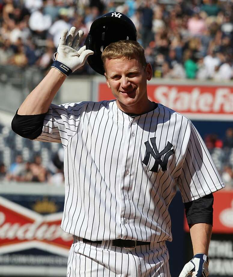 New York Yankees Lyle Overbay removes his helmet after flying out to deep center with two runners on base in the eighth inning of a baseball game against the Oakland Athletics in New York on Sunday, May 5, 2013. (AP Photo/Peter Morgan) Photo: Peter Morgan, Associated Press