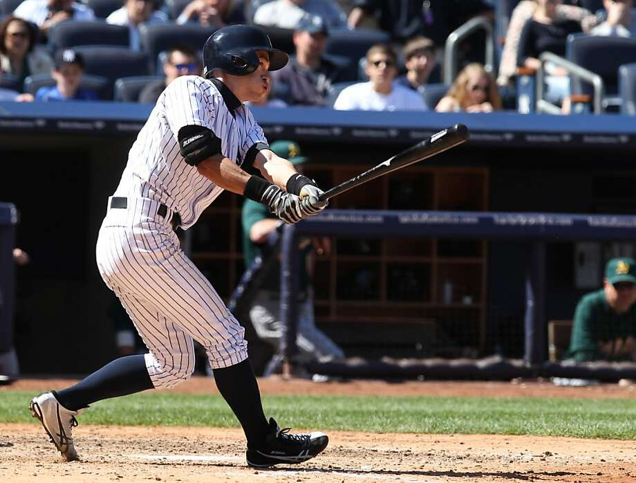 New York Yankees' Ichiro Suzuki hits a run-scoring double in the sixth inning of a baseball game against the Oakland Athletics in New York, Sunday, May 5, 2013. (AP Photo/Peter Morgan) Photo: Peter Morgan, Associated Press