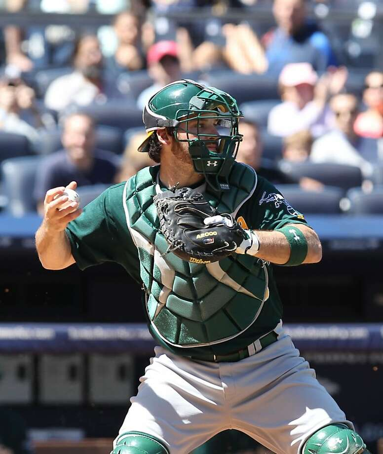 Oakland Athletics catcher Derek Norris throws out New York Yankees  Robinson Cano as he tried to reach second base in the third inning of a baseball game in New York on Sunday, May 5, 2013. (AP Photo/Peter Morgan) Photo: Peter Morgan, Associated Press
