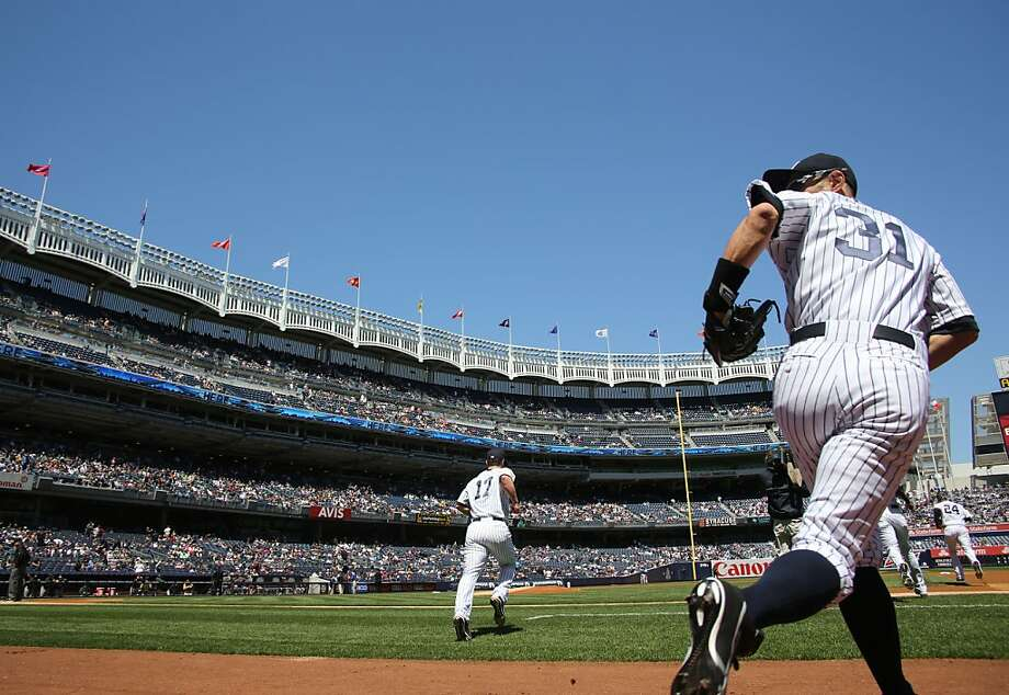 New York Yankees right fielder Ichiro Suzuki takes the field at the start of a baseball game against the Oakland Athletics in New York on Sunday, May 5, 2013. (AP Photo/Peter Morgan) Photo: Peter Morgan, Associated Press