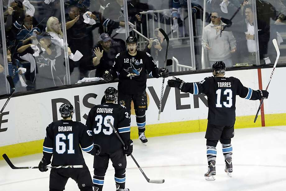 San Jose Sharks center Patrick Marleau (12) celebrates with temmates after scoring against the Vancouver Canucks during the third period of Game 3 of their first-round NHL hockey Stanley Cup playoff series in San Jose, Calif., Sunday, May 5, 2013. (AP Photo/Marcio Jose Sanchez) Photo: Marcio Jose Sanchez, Associated Press