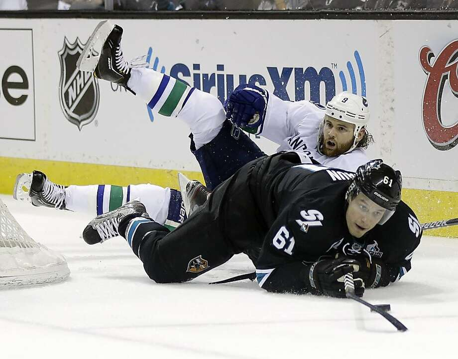 Vancouver Canucks right wing Zack Kassian (9) collides with San Jose Sharks defenseman Justin Braun (61) during the second period of Game 3 of their first-round NHL hockey Stanley Cup playoff series in San Jose, Calif., Sunday, May 5, 2013. (AP Photo/Marcio Jose Sanchez) Photo: Marcio Jose Sanchez, Associated Press