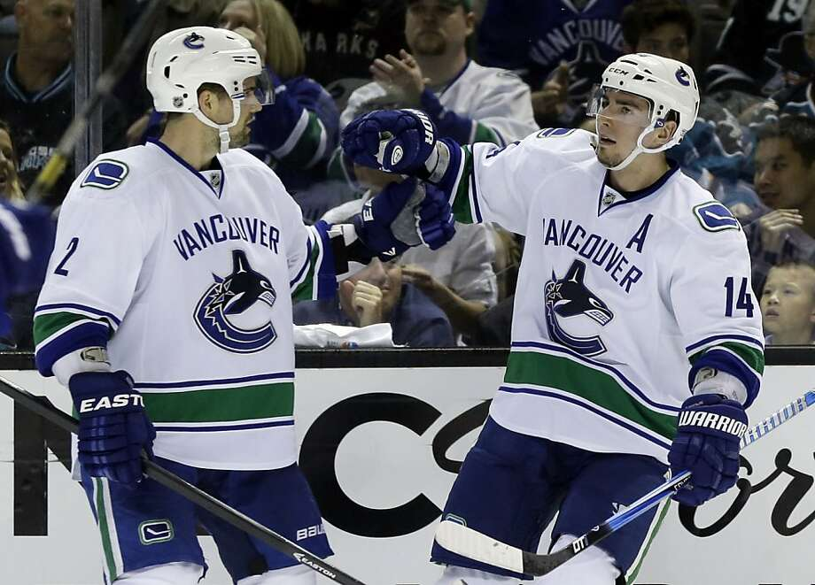 Vancouver Canucks center Alex Burrows (14) celebrates his goal with Dan Hamhuis (2) against the San Jose Sharks during the second period of Game 3 of their first-round NHL hockey Stanley Cup playoff series in San Jose, Calif., Sunday, May 5, 2013. (AP Photo/Marcio Jose Sanchez) Photo: Marcio Jose Sanchez, Associated Press