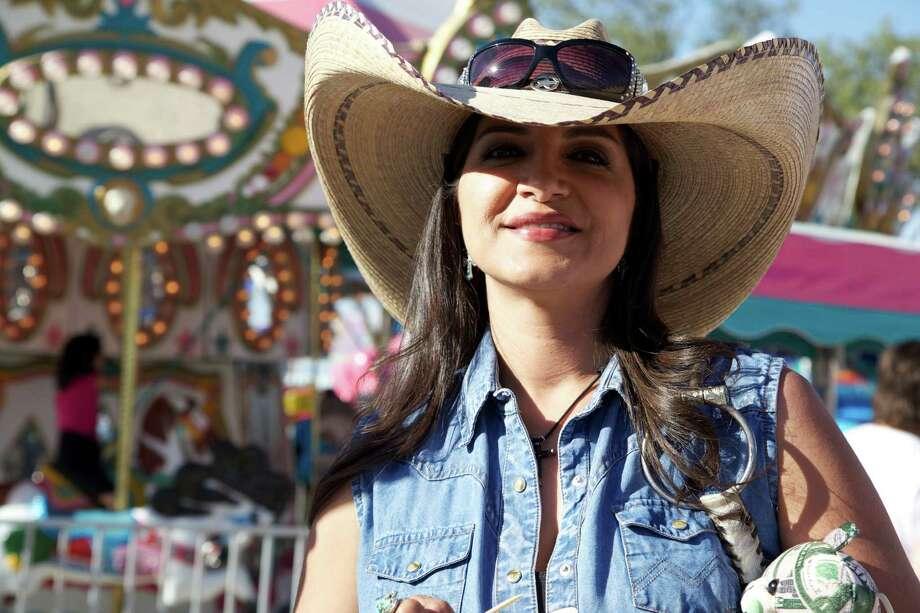 Folks enjoy Cornyval in Helotes on Sunday, May 5, 2013. Photo: Xelina Flores-Chasnoff, For MySA.com