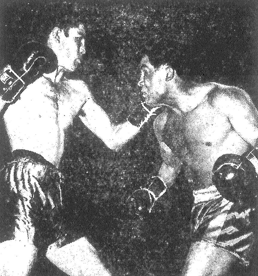Buddy Baggett (left) forces the fight, but Zurdo Galvan beat him to the punch most of the night. Galvan, 118 pounds of fighting fury from Saltillo, won the Texas bantam crown at Municipal Auditorium on a 15-round decision over Baggett of Dallas. Published in the San Antonio Light May 6, 1953. Photo: File Photo