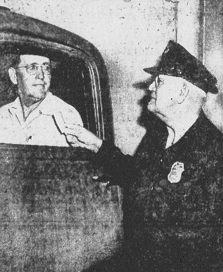 Dave L. Bradshaw, chief guard at the San Antonio terminal market, gives a stall ticket to trucker S.W. Bailey. A photographic memory for faces is one secret of Bradshaw's success. He knows most of the hundreds of drivers by sight and about 80 percent of them by first name. Published in the San Antonio Light May 5, 1953. Photo: File Photo