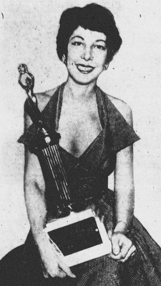 "Miss Marlene Hunt, a telephone operator at Southwestern Bell Telephone Co. of San Antonio, poses with her trophy after she was named the Most Beautiful Telephone Girl in Texas. ""This has really been a break for the tall girls. I was the only 6-foot contestant,"" she said. Published in the San Antonio Light May 5, 1953. Photo: File Photo"